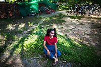 A musician for the Phare Circus relaxes in the yard before a performance in Siem Reap, Cambodia.