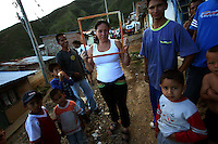 A woman holds an empty picture frame on the streets of Leiva, a small remote village in the southern Colombian state of Nariño, on June 20, 2007. Leiva has long been a coca village; most of the people who live in the area have long relied on the coca business in order to make ends meet. But with increasing pressure by the Colombian government, with fumigation and manual eradication of the coca fields, many people are now trying to figure out what the will do if they can?t rely on their meager coca profits. (Photo/Scott Dalton)