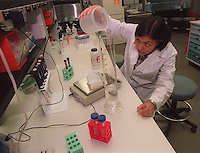 WELLESLEY- Astrid Barrios measures an amount of water needed in an experiment she is conducting. 9/11/97. RESTRICTED USE.NOT FOR REPBULICATION WITHOUT EXPLICIT APPROVAL FROM DIRECTOR OF PHOTOGRAPHY.