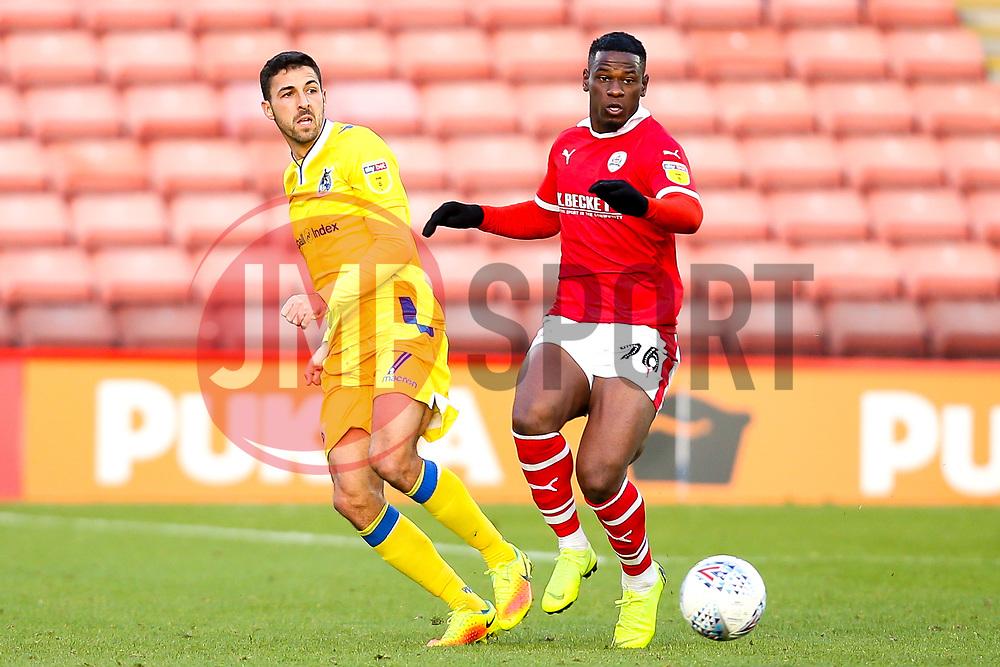 Liam Sercombe of Bristol Rovers takes on Mamadou Thiam of Barnsley - Mandatory by-line: Robbie Stephenson/JMP - 27/10/2018 - FOOTBALL - Oakwell Stadium - Barnsley, England - Barnsley v Bristol Rovers - Sky Bet League One