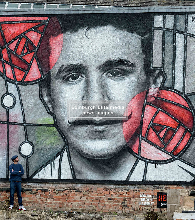 Pictured: Artist Bob McNamara aka Rogue One with the mural.<br /> <br /> A giant street mural, inspired by the work of Charles Rennie Mackintosh, by Art Pistols Projects and artist Rogue-One has been unveiled in Glasgow City Centre. <br /> © Dave Johnston / EEm