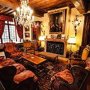 A lavishly decorated sitting area in the foyer of the Hotel le Cep in downtown Beaune, Burgundy, France. Includes fireplace and chandelier.