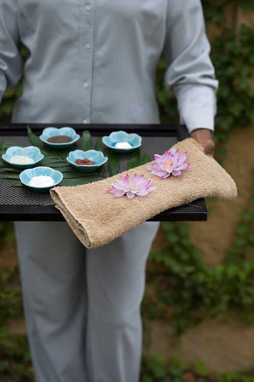A bamboo tray of sea foam lotus bowls filled with nut rub and green tea rub and a rose, camellia and plum hydrating mist from the Umstead Spa in Cary, NC, Sept. 21, 2008.