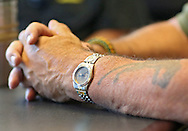 Doug Adamson, of Center Point, wears a Vietnam veterans watch while talking with a reporter at Wells Fargo Bank in Cedar Rapids on Tuesday, July 16, 2013.