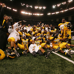 21 December 2008:  Southern Miss players celebrate following a 30-27 overtime victory over the Troy Trojans in the  R+L Carriers New Orleans Bowl at the New Orleans Superdome in New Orleans, LA.