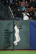 San Francisco Giants center fielder Denard Span (2) misses a fly ball at the wall against the Cincinnati Reds at AT&T Park in San Francisco, California, on May 11, 2017. (Stan Olszewski/Special to S.F. Examiner)
