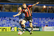 Birmingham City midfielder David Davis tackles Bournemouth midfielder Shaun MacDonald during the The FA Cup third round match between Birmingham City and Bournemouth at St Andrews, Birmingham, England on 9 January 2016. Photo by Alan Franklin.