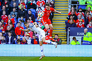 Wales midfielder Harry Wilson and Slovakia defender David Hancko clash in the air during the UEFA European 2020 Qualifier match between Wales and Slovakia at the Cardiff City Stadium, Cardiff, Wales on 24 March 2019.