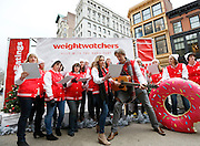 Viral video sensations, Penn and Kim Holderness, lead the Weight Watchers Coaches Chorus in New York's Union Square, to launch Weight Watchers Personal Coaching and 24/7 Expert Chat through re-imagined songs that playfully celebrate the cravings and temptations familiar to the holiday season, Wednesday, December 17, 2014. (Photo by Stuart Ramson/Invision for Weight Watchers/AP Images)