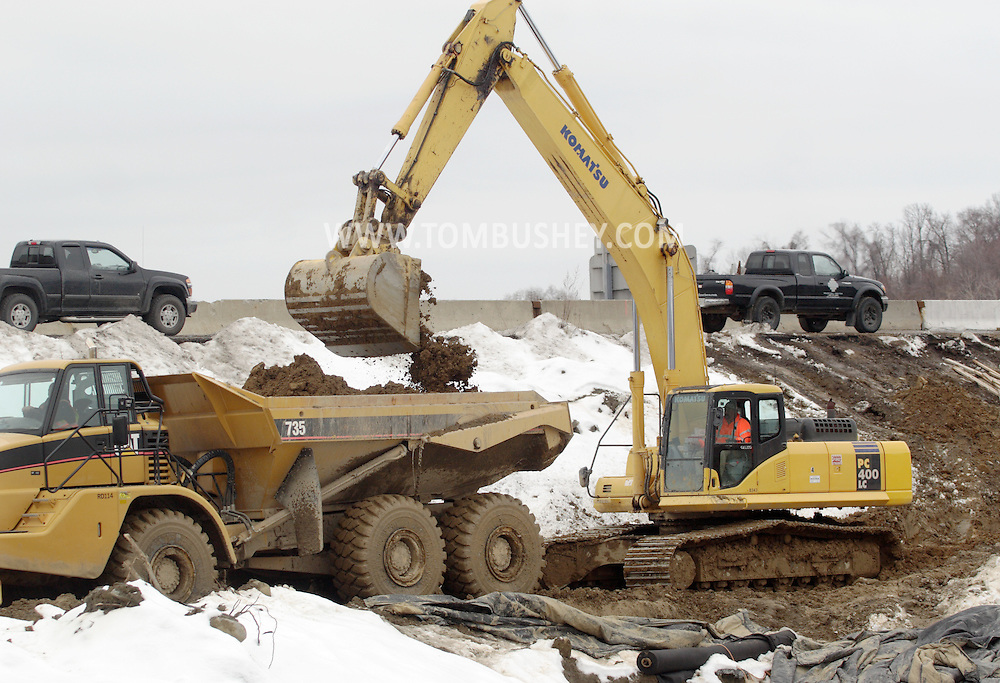 Town of Newburgh, NY - An excavator loads dirt into a dump truck as construction continues on the new Interstate 84-Interstate 87 interchange project on Feb. 27, 2008. Currently there is no direct connection between the two highways. The project is expected to be complete in the fall of 2009.