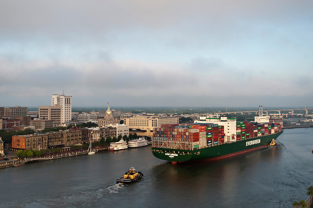 The Evergreen Ever Lissome container ship heads up river past Historic River Street to the Georgia Ports Authority, Sunday, June, 29, 2014, at the Garden City Terminal near Savannah, Ga.  (GPA Photo/Stephen B. Morton)