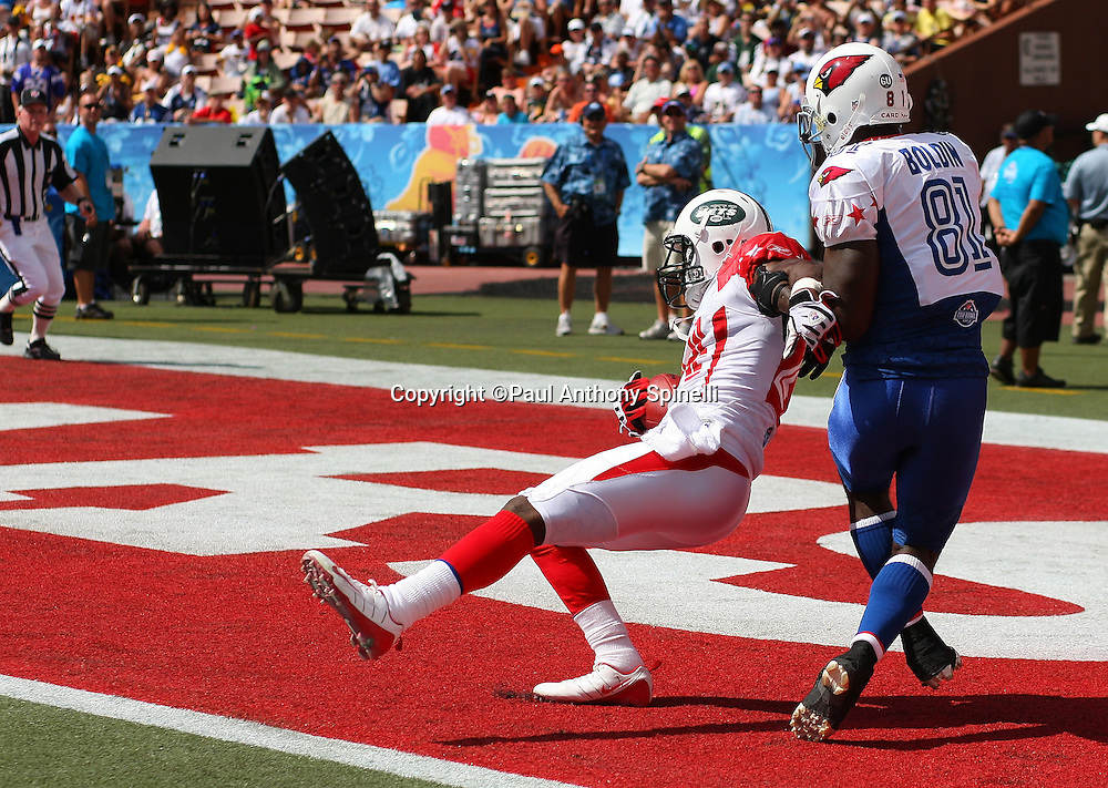 HONOLULU, HI - FEBRUARY 08: AFC All-Stars cornerback Darrelle Revis #24 of the New York Jets intercepts an end zone pass intended for wide receiver Anquan Boldin #81 of the Arizona Cardinals of the NFC All-Stars in the 2009 NFL Pro Bowl at Aloha Stadium on February 8, 2009 in Honolulu, Hawaii. The NFC defeated the AFC 30-21. ©Paul Anthony Spinelli *** Local Caption *** Darrelle Revis;Anquan Boldin