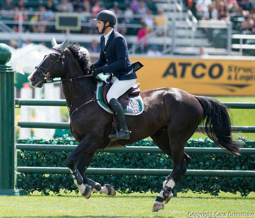 LUIS ALEJANDRO PLACENSIA (MEX) rides ZANDOR in the 1.50m Derby Nexen Cup during National CSI 5* at Spruce Meadows presented by Rolex, June 7 2015. Calgary.