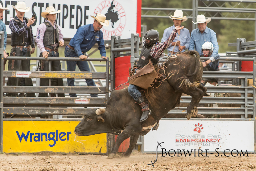 Bull rider Logan Hunter rides Summit Pro Rodeo's All Better during the third performance of the Elizabeth Stampede on Sunday, June 3, 2018.