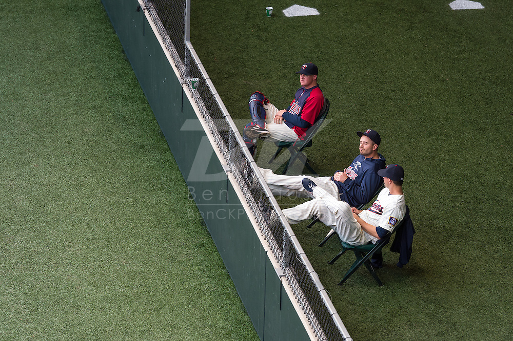 Relievers Brian Duensing #52, Josh Roenicke #20, and bullpen catcher Nate Dammann #75 of the Minnesota Twins relax in the bullpen during a game against the Milwaukee Brewers on May 29, 2013 at Target Field in Minneapolis, Minnesota.  The Twins defeated the Brewers 4 to 1.  Photo: Ben Krause