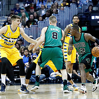 10 March 2017: Boston Celtics guard Terry Rozier (12) drives past Denver Nuggets guard Jamal Murray (27) on a screen set by Boston Celtics forward Jonas Jerebko (8) to face Denver Nuggets forward Juancho Hernangomez (41) during the Denver Nuggets 119-99 victory over the Boston Celtics, at the Pepsi Center, Denver, Colorado, USA.