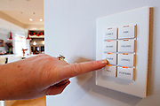 FORT SMITH, AR - JANUARY 7:  Lighting control buttons for the kitchen in the home of Sam and Susan Fiori in Fort Smth, Arkansas that has been wired so that everything is controlled by a touchpad or a iPad.  .CREDIT:Wesley Hitt for The Wall Street Journal.TRAGICTECH