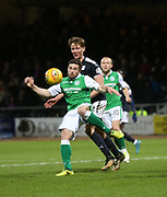 24th January 2018, Dens Park, Dundee, Scottish Premiership, Dundee versus Hibernian; Hibernian's Lewis Stevenson clears from Dundee's Mark O'Hara