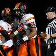 New Hanover's Rome Simpson congratulates Rome Murphy after murphy's touchdown run. (Jason A. Frizzelle)
