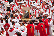 Salvadoran Catholic priests carry a relic - The blood stained shirt - of martyred Archbishop Oscar Romero  through a sea of priests.  The Archbishop was slain at the alter of his Church of the Divine Providence by a right wing gunman in 1980. Oscar Arnulfo Romero y Galdamez became the fourth Archbishop of San Salvador, succeeding Luis Chavez, and spoke out against poverty, social injustice, assassinations and torture. Romero was assassinated while offering Mass on March 24, 1980.