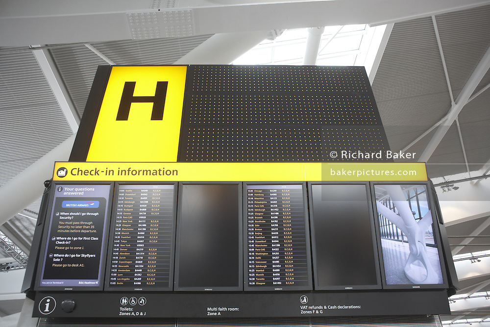 Landside Flight departures information boards in newly-opened London Heathrow Airport's Terminal 5 building.
