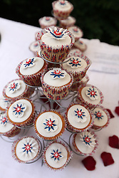 © Licensed to London News Pictures. 04/06/2012. Reading, Berkshire. Special Jubilee cakes at the Shepherds Lane garden party for The Queen's Diamond Jubilee. Photo credit : Rebecca Mckevitt/LNP