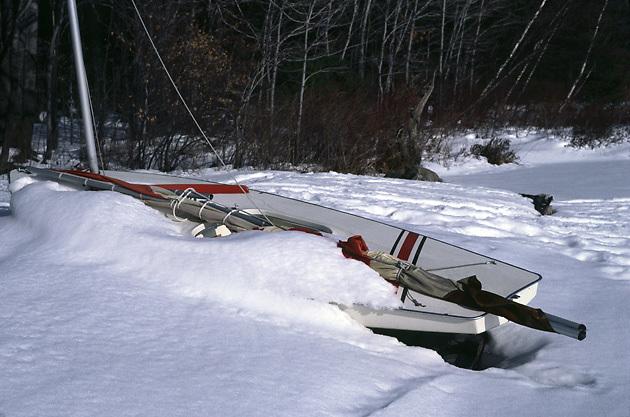 Sunfish sailboat in snow; winter