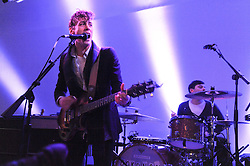 Musician JOHNNY BORRELL performing at the Polo Jeans Co. hosted Art Stars Auction in support of the Teenage Cancer Trust held at Phillips de Pury & Co, Howick Place, London on 6th December 2010.