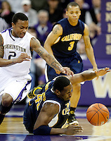 Washington's Isaiah Thomas, left, challenges California's Markhuri Sanders-Fri for the loose ball during the first half of a NCAA college basketball game in Seattle, on Saturday, Dec. 16, 2009. (AP Photo/Kevin P. Casey)
