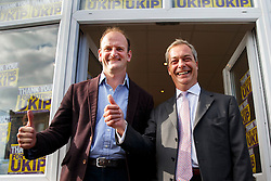 © Licensed to London News Pictures. 10/10/2014. Clacton, UK. Douglas Carswell, newly elected and first ever MP of UKIP for Clacton-on-Sea and UKIP leader Nigel Farage leaving UKIP campaign office in Clacton town centre on Friday, 10 October, 2014 after their victory in the by-election of Clacton-on-Sea. Photo credit : Tolga Akmen/LNP
