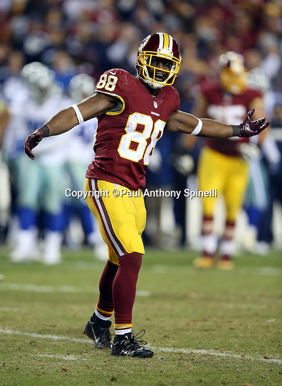 Washington Redskins wide receiver Pierre Garcon (88) complains to an official during the 2015 week 13 regular season NFL football game against the Dallas Cowboys on Monday, Dec. 7, 2015 in Landover, Md. The Cowboys won the game 19-16. (©Paul Anthony Spinelli)
