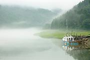 Fishing boat in fog<br /> Alma<br /> New Brunswick<br /> Canada
