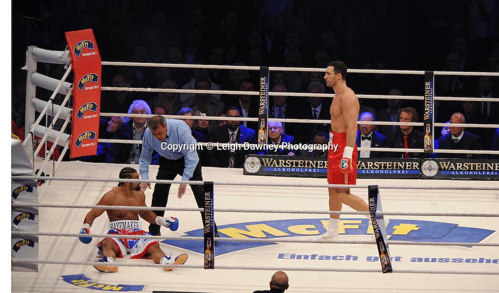 Wladimir Klitschko knocks down David Haye and goes on to claim the WBO, WBA & IBF Heavyweight Title at Imtech Arena, Hamburg, Germany, 2nd July 2011. Photo credit: Leigh Dawney 2011