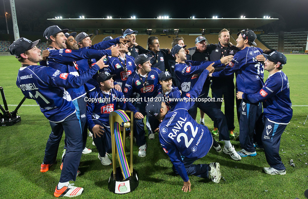 Auckland Aces celebrate with the trophy. Georgie Pie Super Smash final, Otago Volts v Auckland Aces, Yarrow Stadium, New Plymouth, New Zealand. Sunday 13 December 2015. Copyright Photo: John Cowpland / www.photosport.nz
