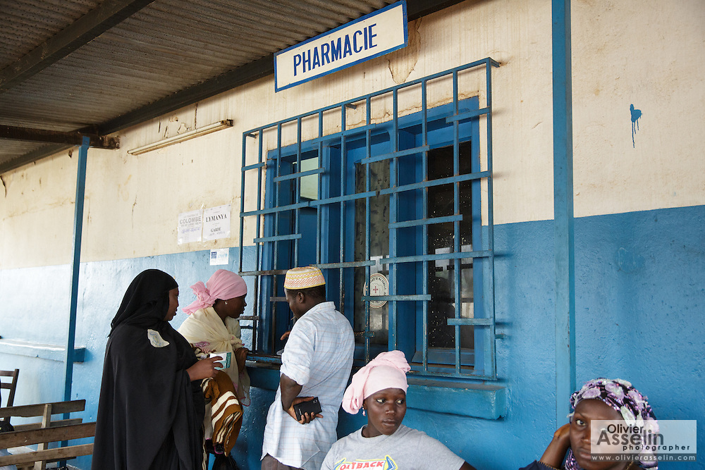Patients wait to pick up their prescriptions at the pharmacy counter of the Libreville health center in Man, Cote d'Ivoire on Wednesday July 24, 2013.