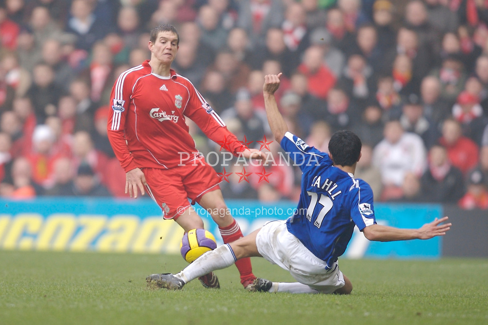 Liverpool, England - Saturday, February 3, 2007: Liverpool's Daniel Agger and Everton's Tim Cahill during the Merseyside Derby Premiership match at Anfield. (Pic by David Rawcliffe/Propaganda)