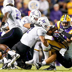 Oct 26, 2013; Baton Rouge, LA, USA; LSU Tigers wide receiver Odell Beckham (3) is tackled against the Furman Paladins during the first half of a game at Tiger Stadium. Mandatory Credit: Derick E. Hingle-USA TODAY Sports