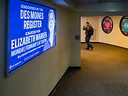 31 JANUARY 2020 - DES MOINES, IOWA: A person walks past an Elizabeth Warren ad in the Des Moines Skywalk. Downtown Des Moines is preparing the caucuses, which are Monday, February 3. The city has hung banners throughout the city center and put signs in the skywalk. Some candidates are also buying advertising in the skywalk.   PHOTO BY JACK KURTZ