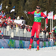 Winter Olympics, Vancouver, 2010.Petter Northug, Norway, wins the Gold Medal for himself and team mate Oeystein Pettersen as he crosses the finish line ahead of German in the Men's  Team Sprint Free at Whistler Olympic Park , Whistler, during the Vancouver Winter Olympics. 22nd February 2010. Photo Tim Clayton