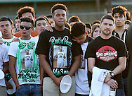 Classmates and basketball teammates of Eric's Medina,  gather together for a candlelight vigil for Eric Medina at Pasadena High School on Sunday, May 3, 2015 in Pasadena, TX. Eric Rodriguez had a heart attack and died during a routine physical at school. Photo: Thomas B. Shea, For The Chronicle / © 2015