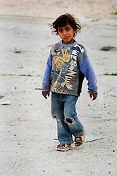 A Young Iraqi girl walking towards a British Army patrol of Royal Dragoon Guards passes through Umm Qasr area Southern Iraq near the Kuwait border, while on Op-Telic in March 2005