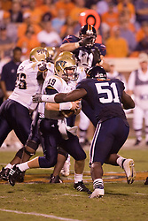 Virginia linebacker Clint Sintim (51) sacks Pittsburgh quarterback Pat Bostick (19)...The Virginia Cavaliers defeated the Pittsburgh Panthers 44-14 at Scott Stadium in Charlottesville, VA on September 29, 2007.