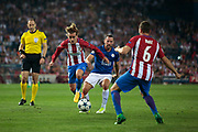 April 12th 2017, Madrid, Spain; UEFA Champions League football quarterfinal, leg 1, Atletico madrid versus leicester City; Antoine Griezmann (left) passes the ball to Koke (right), both from Atletico de Madrid, with the opposition of Danny Drinkwater from Atletico de Madrid