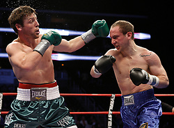 Apr 24, 2009; Newark, NJ, USA; John Duddy (green/white) and Billy Lyell (blue) trade punches during their 10 round  middleweight fight at the Prudential Center.  Lyell scored a huge upset over the previously unbeaten Duddy via split decision.