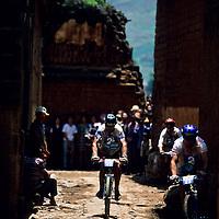 Biker in village, 1999 Mild Seven Outdoor Quest Adventure Race, Lijiang, China