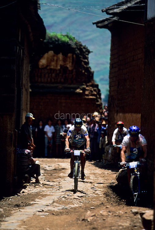 Biker in village, 1999 Mild Seven Outdoor Quest Adventure Race, Lijiang, China