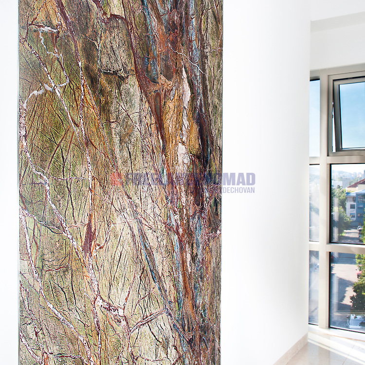 Multicolor natural stone on wall