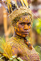 Portrait of a young woman from the Okapa tribe. She is dressed in traditional tribal dress for the Goroka Show, an annual Singsing Festival in the highlands of Papua New Guinea