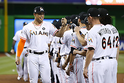 April 10, 2017 - Miami, FL, USA - Miami Marlins outfielder Giancarlo Stanton high-fives teammates before the start of the team's home opener, against the Atlanta Braves, at Marlins Park in Miami on Tuesday, April 11, 2017. (Credit Image: © David Santiago/TNS via ZUMA Wire)