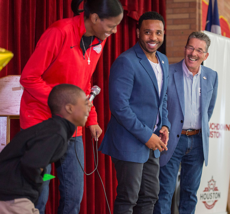 Chameka Scott, JJ Moses and Lewis Senior share a laugh with students during a Touchdown Houston literacy program at NQ Henderson Elementary School, November 11, 2016.during a Touchdown Houston event at NQ Henderson Elementary School, November 11, 2016.